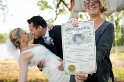 Spike with marriage certificate and happy couple